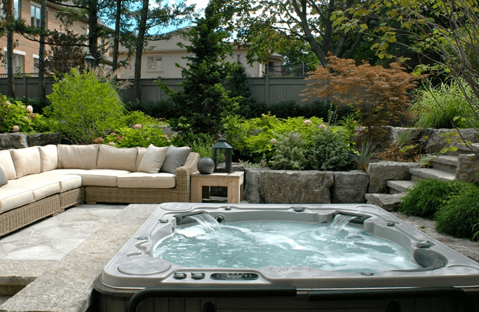 Sunken Backyard Lounge with a Hot Tub